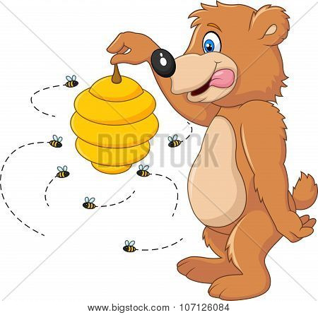 Cute bear holding Bee hive