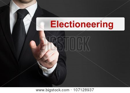 Businessman Pushing Flat Touchscreen Button Electioneering