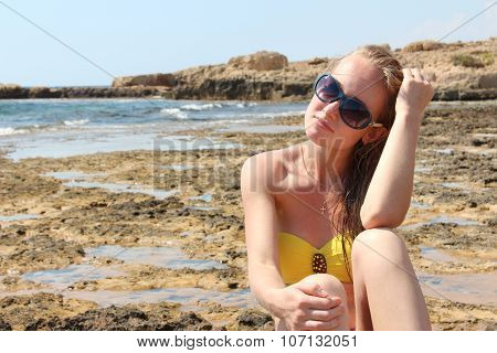 Beautiful young woman relaxing on the beach.