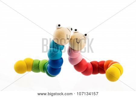 Happy Wooden Baby Toys Worms Isolated On White