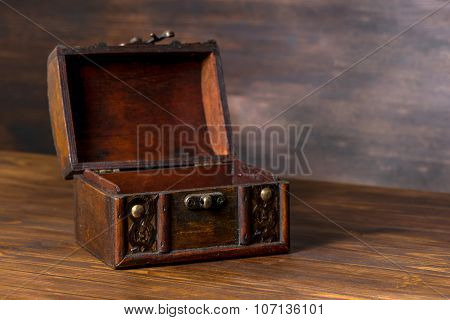 Beautiful Vintage Chest With Open Lid On Wooden Background, Closeup