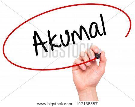 Man Hand writing Akumal with black marker on visual screen.
