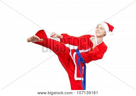 In a cap and dressed Santa Claus athlete beats blow leg