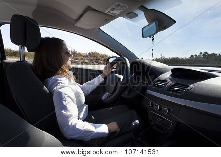 Businesswoman driving a sports car