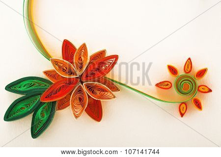 Paper Flower On A Greeting Card Close-up Made With Quilling Technique