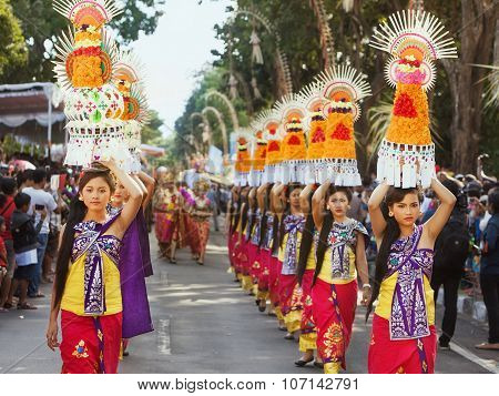 Procession Of Balinese Women Carrying On Heads Religious Offering