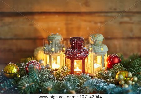 Christmas Lanterns And Baubles In Snow
