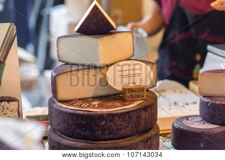 LONDON - JUN 12, 2015: Cheese shop in London. A variety of cheeses for sale at Borough Market