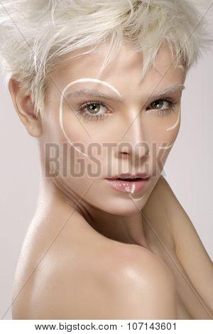 Beautiful Blond Model Wearing Elegant Artistic Makeup