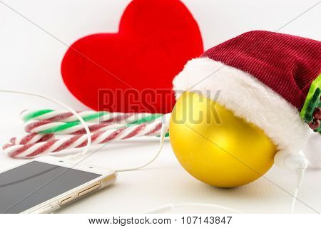 Christmas Ball With Santa's Hat And Earphones With Ornaments On White