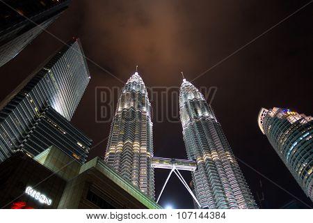 Kuala Lumpur - December 26: Petronas Towers On Dec 26, 2014 In Malaysia. The Towers Are Twin Skyscra