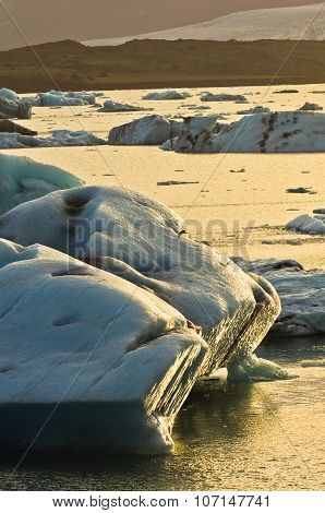Melting of icebergs in Jokulsarlon glacier lagoon at sunset