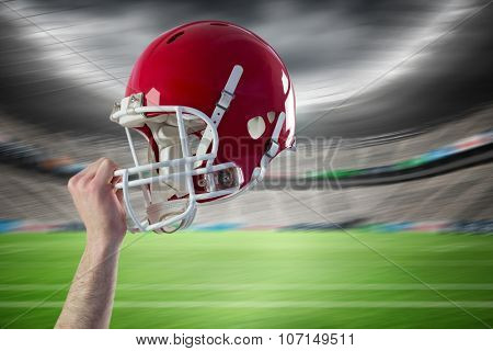 Helmet of an american football player against rugby stadium