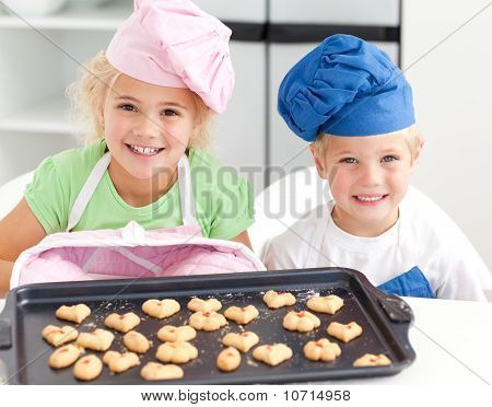 Happy Little Brother And Sister With Their Biscuits Ready To Eat