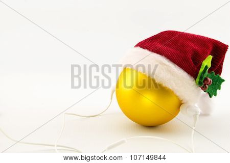Christmas Ball With Santa's Hat And Earphones, Isolated On White With Copy-space