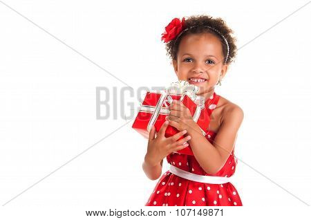 Portrait Of A Smiling Girl Mulatto With Curly Hair And A Gift In Hands. Birthday Or New Year Present