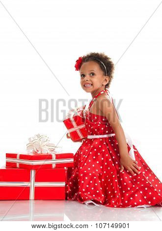Merry Girl With Curly Hair And Red Gift Boxes. Shopping, Presents, Holiday, Congratulations