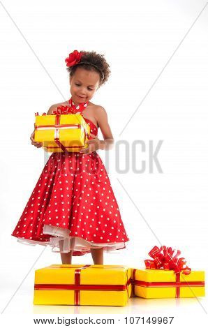 Little Lady In A Red Dotted Dress With Yellow Gift Boxes. Birthday, New Year