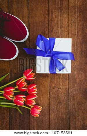 Close up ew of red flowers and blue gifts