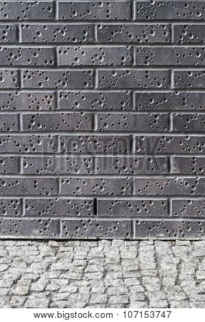 Dark Brick Wall And Grey Pebble Floor
