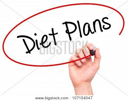 Man Hand writing Diet Plans with black marker on visual screen.