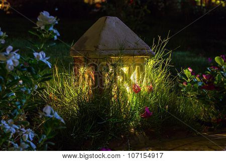 Small Garden Lamp On Surrounded Grass Field