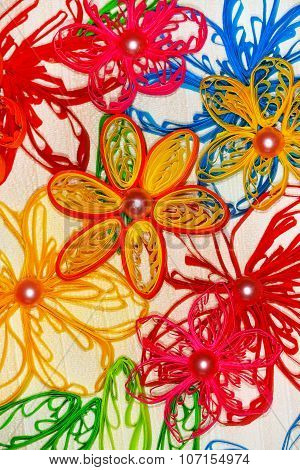 Flower applique made in the technique of quilling
