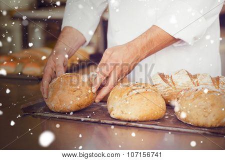 Snow against baker checking freshly baked bread