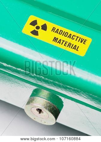 Box with warning sticker and lock containing radioactive materials