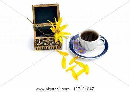 The Open Casket And Cup Of Coffee Decorated With Florets