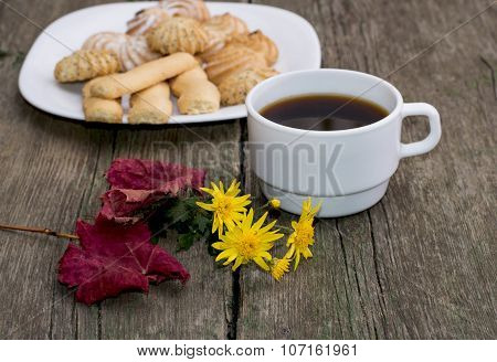 Coffee, Leaf, Floret And Plate With Cookies Behind, A Still Life