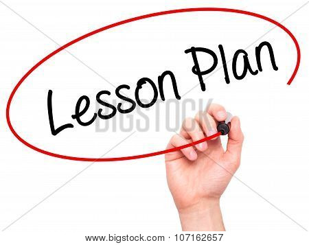 Man Hand writing Lesson Plan with black marker on visual screen.