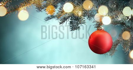 Red Christmas ball hanging on Christmas tree.