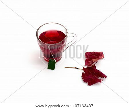 Transparent Mug With Red Tea And A Row A Red Leaf, Isolate, A Still Life