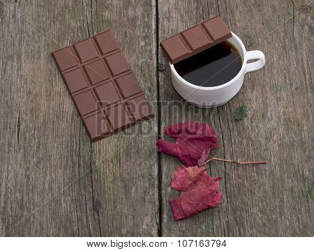 Coffee, A Piece Of Chocolate On A Cup, Nearby Chocolate And A Red Leaf