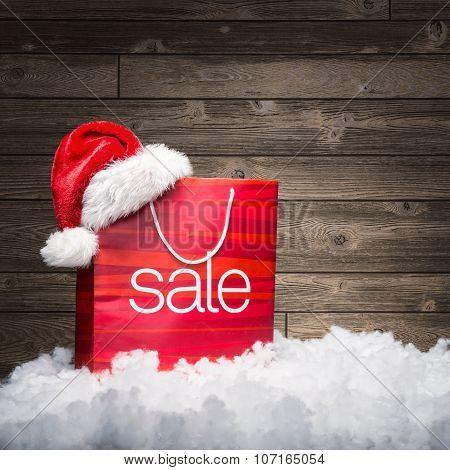 Christmas - Sale bag rebate on wood background