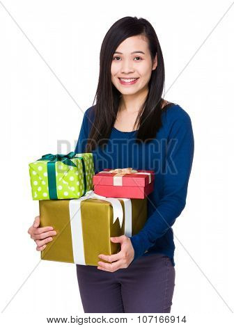 Asian Woman hold with many present box