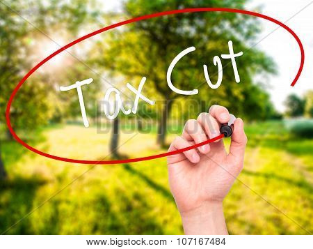 Man Hand writing Tax Cut with black marker on visual screen.