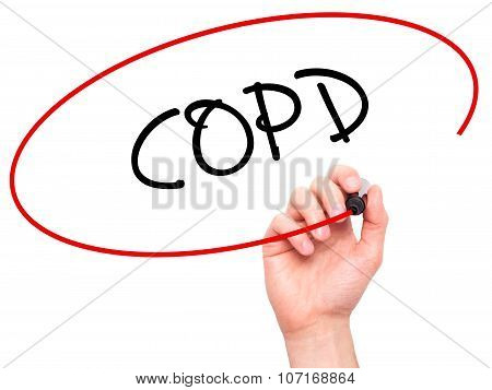 Man Hand writing COPD with black marker on visual screen.