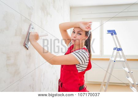Tired Woman Grinding Wall