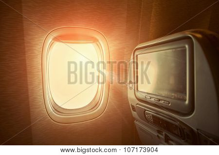 Window in airplane with sunlight.