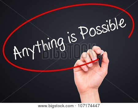 Man Hand writing Anything is Possible with black marker on visual screen.