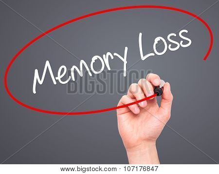 Man Hand writing Memory Loss with black marker on visual screen.