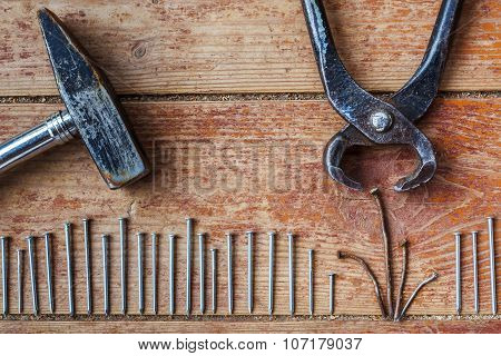 Hammering in new nails, pliers pull out nails bad