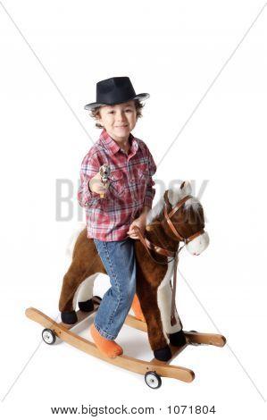 Adorable Kid Riding A Toy Horse