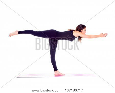 Beautiful woman doing Virabhadrasana 3 pose on yoga class, Studio shot.