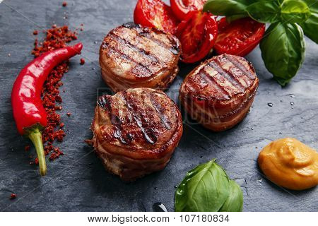 Grilled meat fillet steak wrapped in bacon medallions
