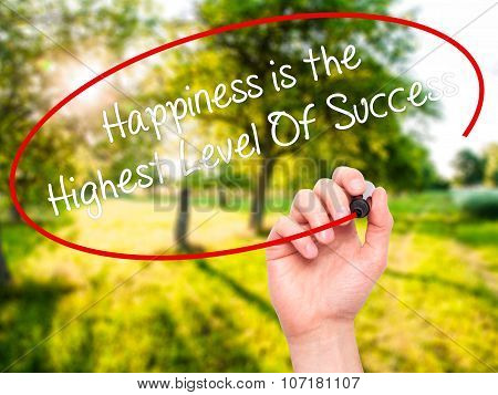 Man Hand writing Happiness is the Highest Level Of Success with black marker on visual screen