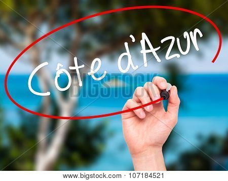 Man Hand writing Côte d'Azur with black marker on visual screen