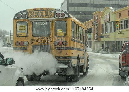 School bus in traffic on a snowy Canadian street